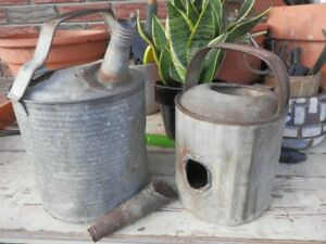 TWO VINTAGE  WATERING CANS