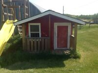 Playhouse with deck and built in toy storage