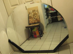 For sale large oval beveled mirror with a wood frame