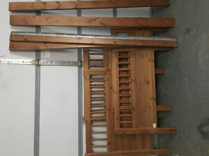 Two solid wood stained bed frames