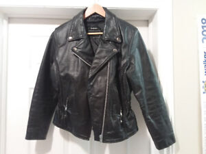 Lady's leather motorcyle jacket, and chaps.