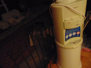 1 water cooler The white one cooler has hot water for tea or co