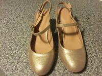 Ladies gold shoes size 5