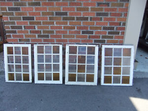 21 various sized vintage storm windows with antique glass