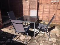 Garden set: table, 4 chairs & umbrella, brand new.