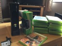 xbox 360 with new controller and 20+ games and plus and play