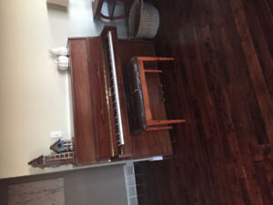 Piano with piano bench
