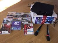 PlayStation PS3 slim 160gb with singstar mics and 13 games.