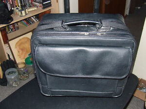 Wheeled Leather Lap Top/Travel Bag With Shoulder Strap - $18.00