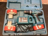 Makita combi drill set in case with 3 batteries