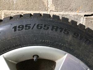 Pneus d'hiver WinterCraft, 195/65 R15  monté sur mags de Mazda