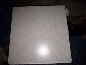215 sqf of 12x 12 Off white ceramic tile