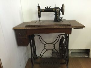 Antique Sewing machine with cabinet