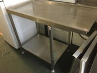 Stainless steel table with slide on one side