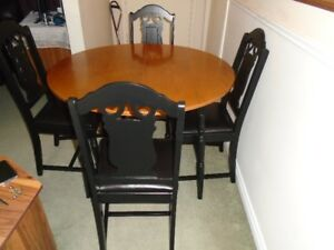 Table and 4 chairs with newly upholstered chairs