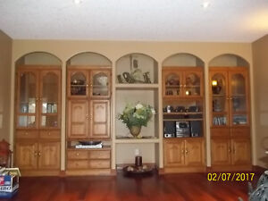Solid wood, 4pc wall unit, light inside. Great condition