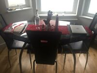 Glass 2 tier table & X4 black chairs with red runner and reversible red and black matts