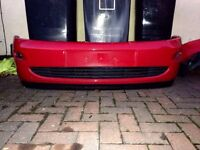 Ford Focus mk1 red front and rear bumpers