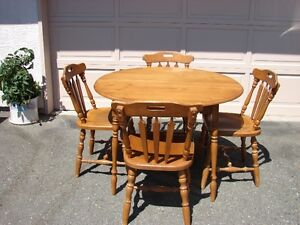 nine piece dining set with table leaves