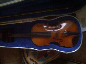 VIOLIN WITH CASE AND TWO BOWS