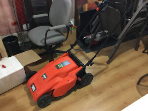 Battery operated lawn mower, used 1 month