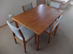 Teak Dining room table + cabinet and solid wood bookcases