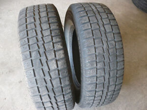 Two 235-70-16 snow tires $70.00