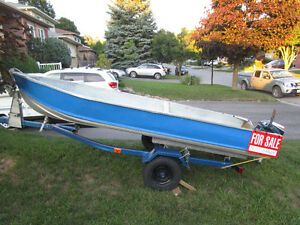 14 ft Sterling boat ,9.5 Evinrude and trailer.