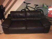 Dark brown leather sofa and chair
