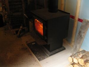 Two Wood Stoves For Sale