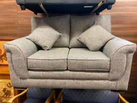 Grey material 2 seater sofa