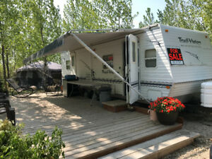 Seasonal site with 27 ft camper & more!