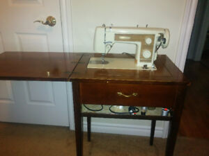 Omega sewing machine and cabinet