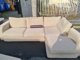 18. Cream material corner sofa and footstool/coffee table