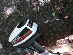 Honda outboard and boat for trade