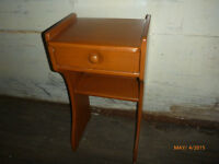 A single pine nightstand in excellent condition.
