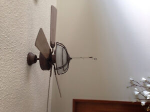 Set of ceiling fans with a wooden finish