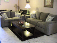 SOFA & LOVESEAT with nail-head accents in neutral, quality fabri