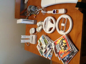 Wii console w/ 8 games and accessories