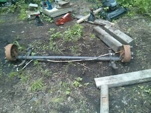 3500lb 4 inch drop axle c/w springs, brakes & rims