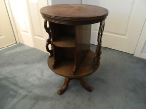 Vintage round table with swivelling shelves