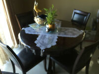Dining table and four chairs in a Very Good Condition