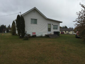 Cottage on one acre lot, Mill River East