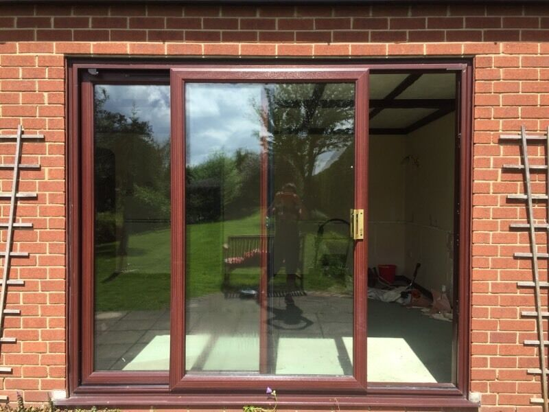 Large brown patio doors with frame in rayleigh essex for Brown upvc patio doors
