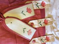 Pair of terracotta mid length curtains with tie backs