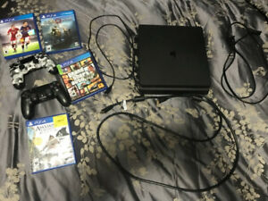 PS4 with 2 Controllers and games