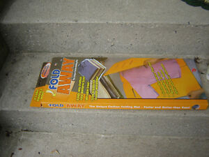 FOLD AWAY(AS SEEN ON TV)/GADGET FOR FOLDING CLOTHES London Ontario image 2
