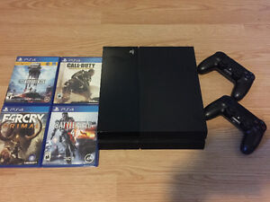 PS4 with 2 controlers + 4 games *PERFECT CONDITION*