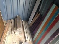 Entire contents of container, pallets wood, oil barrels, solid wood door, chairs etc
