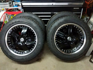 "Four 20"" American Racing Rogue rims with Tires"